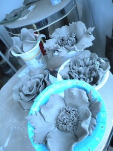 Beautiful flowers waiting for the kiln.